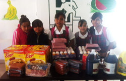 Casa Betesda Children receiving food supplies