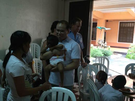 Dental Departures Team share prepared food for children
